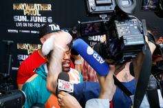 Floyd Mayweather Puts Jake Paul In Headlock After Getting Hat Snatched