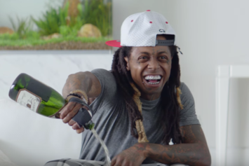 Lil Wayne Pours Champagne On His Phone In New Samsung Ad