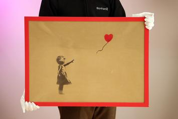 """Banksy Destroys """"Girl With A Balloon"""" Painting After It Sells For $1.2 Million: Watch"""