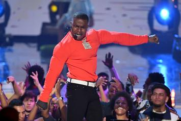 DaBaby Watches On As Fan Who Jumped On Stage Gets Handled By Security