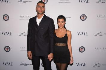 Kourtney Kardashian & Younes Bendjima Seemingly Rekindle Romance At Christmas Party