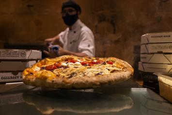 Company Offering $500 For Someone To Eat Pizza & Watch Netflix