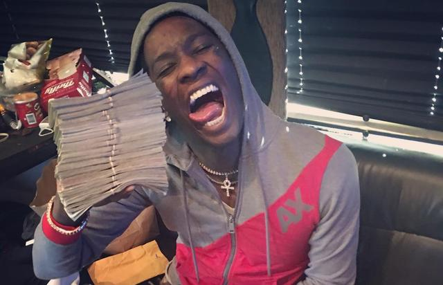 Young Thug with a pile of cash