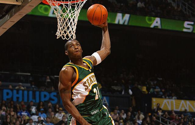Desmond Mason #24 of the Seattle Sonics makes a dunk to go on to win second place at the Sprite Rising Stars Slam Dunk Contest during the 2003 NBA All-Star Weekend at Philips Arena on February 8, 2003 in Atlanta, Georgia.
