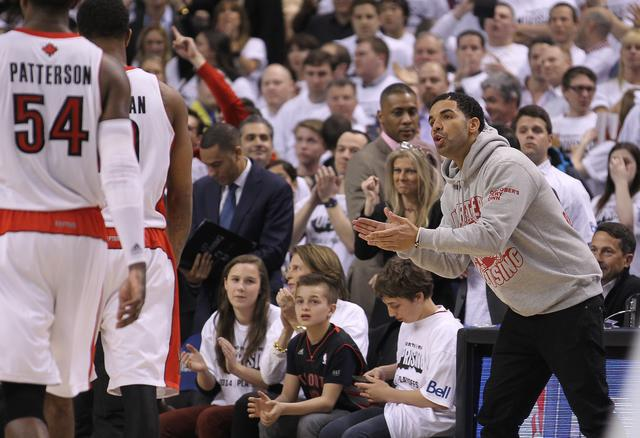 Rap star Drake cheers as the Toronto Raptors take on the Brooklyn Nets in Game Two of the NBA Eastern Conference Quarterfinals at the Air Canada Centre on April 22, 2014 in Toronto, Ontario, Canada.