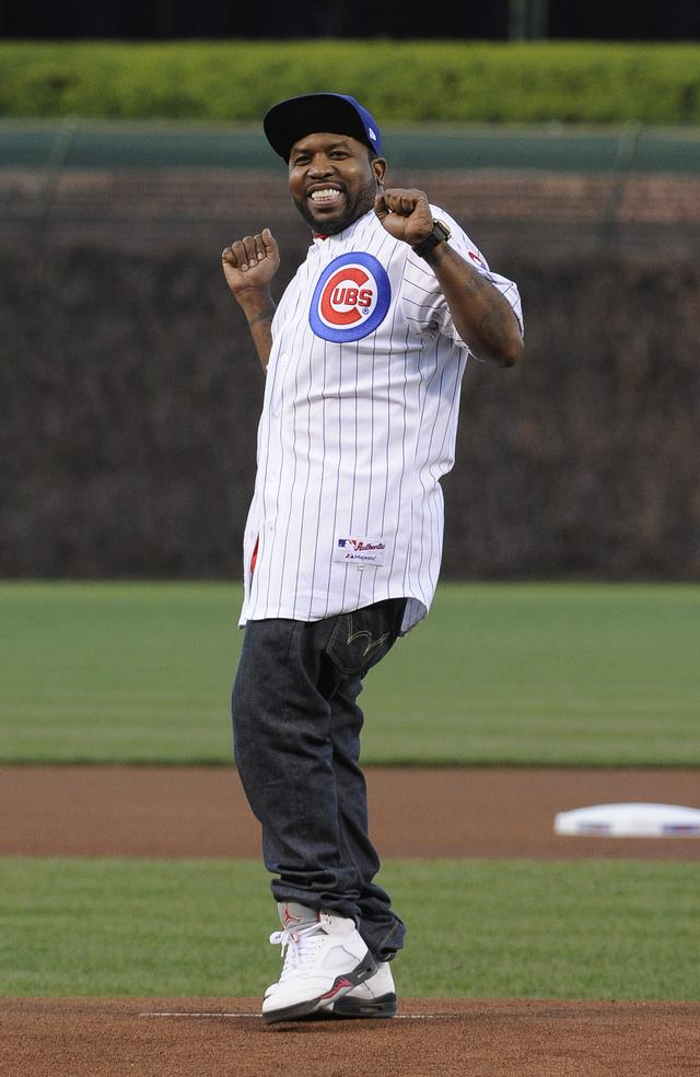 Musical artist Big Boi from the group Outkast throws out the first pitch before the game between the Chicago Cubs and the San Diego Padres on May 1, 2013 at Wrigley Field in Chicago, Illinois
