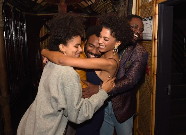 Donald Glover hugging his co-stars of Atlanta tv show