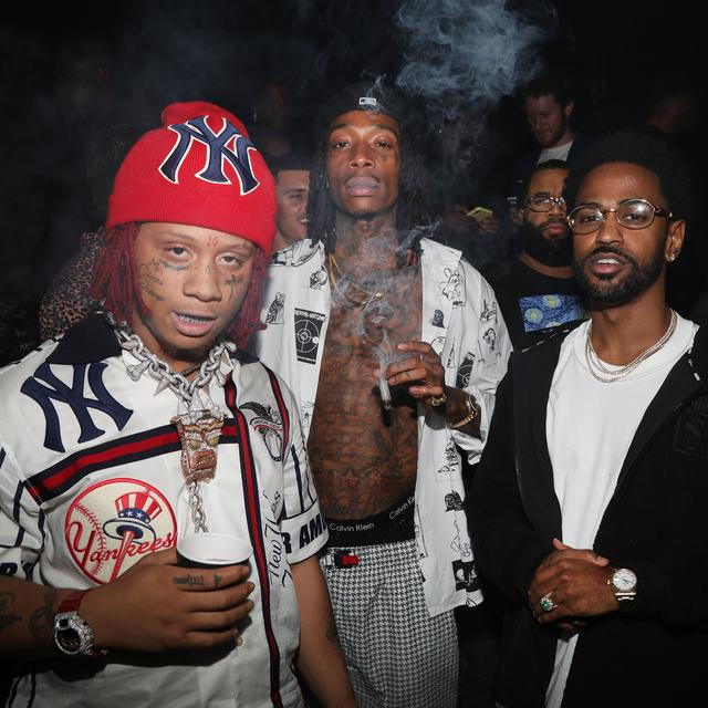 (L-R) Rappers Trippie Redd, Wiz Khalifa and Big Sean attend Lil Wayne's 36th birthday party and Carter V release at HUBBLE on September 27, 2018 in Los Angeles, California.